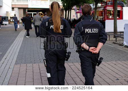 Frankfurt am Main - September 15 2017: Police officers patrolling at international Motor Show on September 15 2017 in Frankfurt, Germany