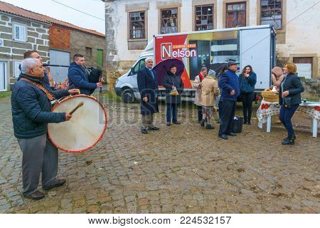 DUAS IGREJAS, PORTUGAL - DECEMBER 26, 2017: Villagers play music and take part in the celebration of Santo Estevao, as part of Christmas event, in Duas Igrejas, Portugal