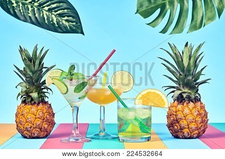 Two Pineapple with Cocktail on Beach. Tropical Fruit Pineapple. Bright Summer Color. Fashion Style. Creative Art. Fun Summer party Mood