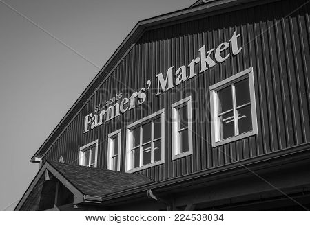 ST. JACOBS, CANADA - APRIL 25, 2017: Sign on exterior upper floor of St. Jacobs Farmers' Market. This market is a major tourist attraction to southwestern Ontario.