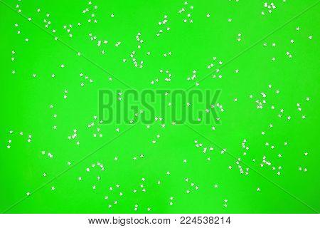 Gold metallic stars on a green background