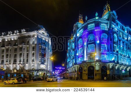 MADRID, SPAIN - DECEMBER 30, 2017: Scene of Plaza de las Cortes, with Christmas decorations, locals and visitors, in Madrid, Spain