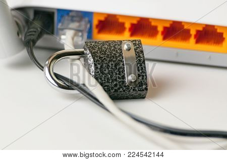 Lock unlock security on a computer. Protecting the Internet connection through a wi-fi router is a concept of a security breach. Cyber security