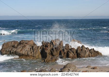 This is an image of spray from an incoming waive along the coast of Pacific Grove, California.