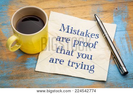 Mistakes are proof that you are trying - hadwriting on a napkin with a cup of coffee