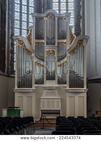 DORDRECHT, NETHERLANDS - OCTOBER 27, 2017: The Bach organ of the Grote Kerk was build in 2007 by Verschueren Orgelbouw. It is very suitable for playing baroque music from Bach and others.
