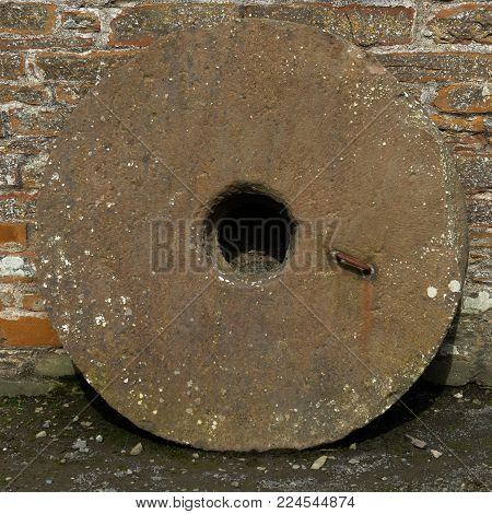 An Old Mill Stone at a grain mill
