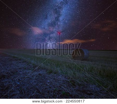 Starry sky over stubble field, fine art landscape. Dreamy landscape