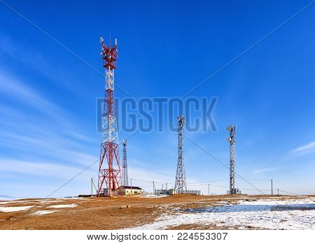 Base transceiver station of cellular communication and mobile Internet. High steel masts with long range equipment. Olkhon Island. Irkutsk region. Russia