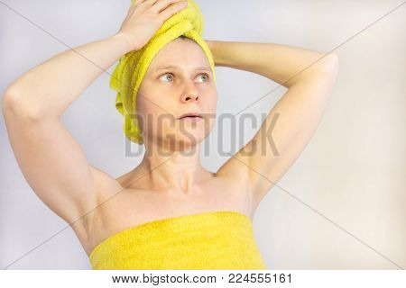 A woman stands with a towel on his head. the girl in the sauna. hot. beautiful girl in the bath.