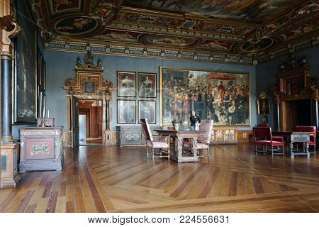 HILLEROD, DENMARK - DECEMBER 27, 2016: Visitors in Frederiksborg Castle. It was built as a royal residence for King Christian IV and becoming the largest Renaissance residence in Scandinavia