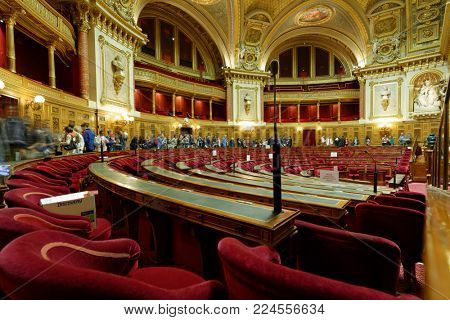 PARIS, FRANCE - SEPTEMBER 14, 2013: Tourists in the Meeting hall of Senate in the Luxembourg Palace during European Heritage Day. The palace was originally built in XVII century