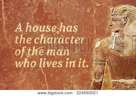 A house has the character of the man who lives in it - ancient Egyptian proverb printed on red grunge wall