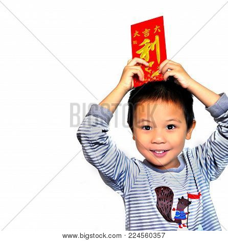 Closed up Smiling asian child is holding red packets and Chinese word all meaning profit, isoleted on white backgrond, chinese new year concept
