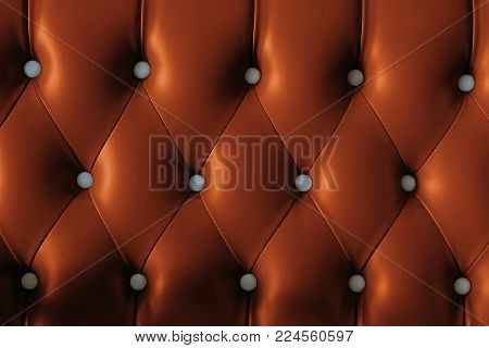Retro Chesterfield Style, Brown Capitone Textile Background