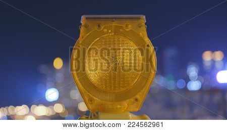 Safety Caution yellow light in the city at night