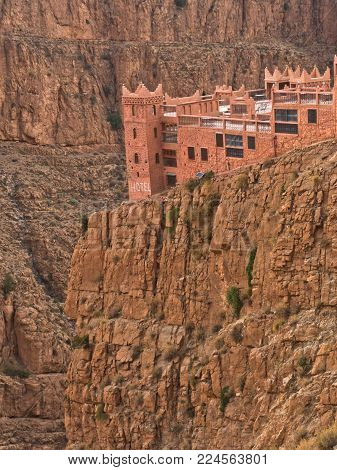 Hotel in casbah style at the edge of a cliff at Dadas Gorge in Morocco, Africa