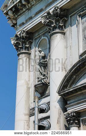 Old statue on facade of the Church of Santa Maria del Rosario (Gesuati). Venice, Italy