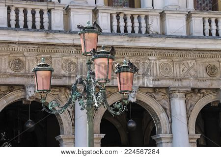 Old lantern on famous St. Mark's Square in Venice, Italy