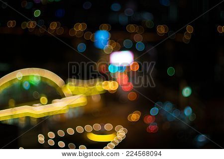 Blurred lights train station in bangkok at night time