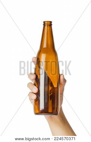 Woman's Hand Holding Empty Beer Bottle Transparent On White Background, File Contains A Clipping Pat