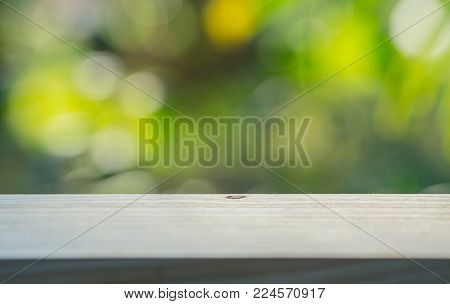 brown wooden floor with nature blurred background