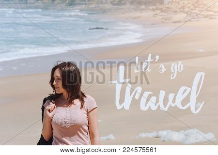Travel quote, words Let's Go Travel. Summer vacation happiness carefree joyful woman standing on sand enjoying tropical beach. Lonely traveler on the ocean coast