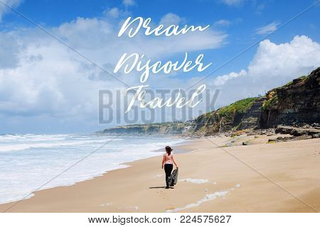 Travel quote, words Dream Discover Travel. Summer vacation happiness carefree joyful woman standing on sand enjoying tropical beach. Lonely traveler on the ocean coast