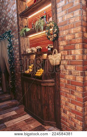 Interior cafe. Wooden niche with shelves and fruit baskets