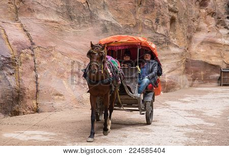Carriage With Passengers Ride In Al Siq Passage To Ancient Petra Town