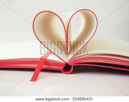 Red Paper Heart Made From Book Pages