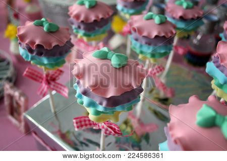 Party cupcake, fondant colorful birthday party cupcake.