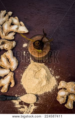 Close up of Extracted oil of dried ginger,Zingiber officinale or soth with raw dried ginger.