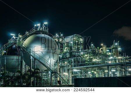 Gas storage sphere tanks in petrochemical plant with night, Glitter lighting of petrochemical plant