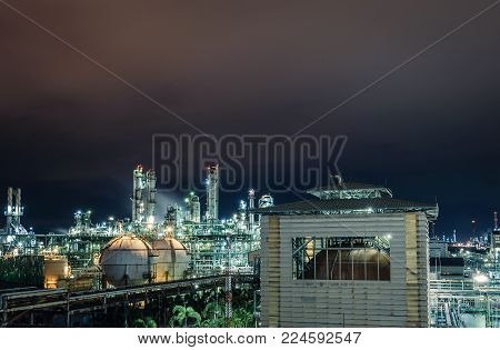 Petrochemical industry plant with night, Glowing lighting of petroleum industrial estates