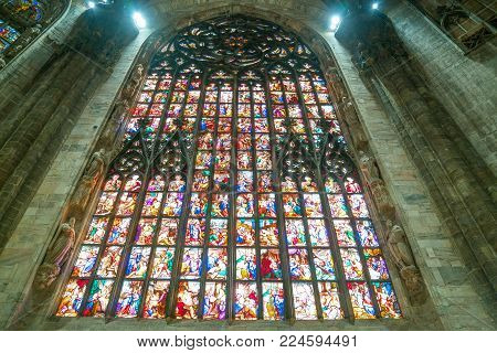 Milan, Italy - October 27, 2016: The interior of the Duomo Cathedral, the colorful stained glass of the apse