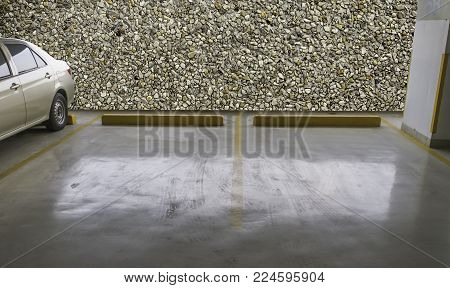 indoor empty parking car with stone wall