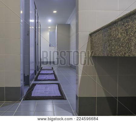 public modern bathroom with white locker inside