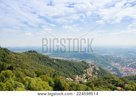 BRUNATE, ITALY - SEPTEMBER 4, 2017: Views of landscape from the Lighthouse Voltiano. Lighthouse named Alessandro Volta. Viewpoint from the top of Brunate.