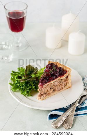 A Piece of Christmas Meat Pie with Cranberry Sauce Topping, copy space for your text
