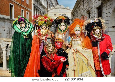VENICE, ITALY - FEBRUARY 28Group of Venice Carnival Mask with the famous Bridge of Sighs February 28, 2017 in Venice, Italy