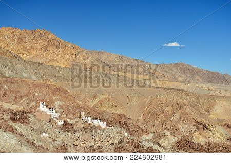 View on the beautifully located Buddhist monastery in the Basgo village in the background one can see the mountains Ladakh is admiring the beautiful Karakorum panorama. This region is a purpose of motorcycle expeditions organised by Indians