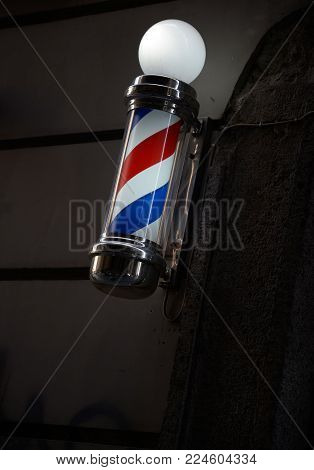Barber's pole with space for text in dark backround