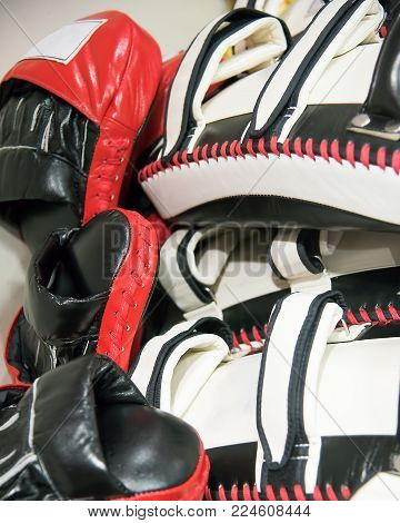 Punching pads, mitts or bags lying stack after mix martial art training
