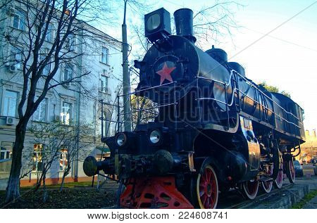 old steam locomotive stands on a pedestal in Moscow
