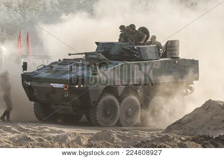 BORNE SULINOWO, WEST POMERANIAN / POLAND: Polish military wheeled armored personnel carrier ROSOMAK during demonstrations at a meeting of military enthusiasts