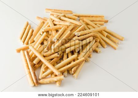 Crispy flour sticks lined on a white background