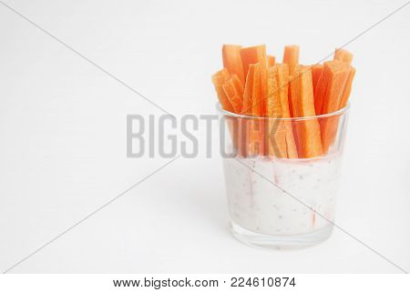 Vegan Snack Carrot Batons in a Glass Cup Served as Crudites Isolated