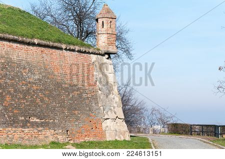Guardhouse with loopholes on the corner of the old aged brick fortress building