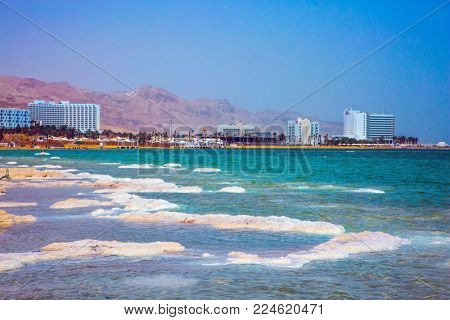 Israel, spring. Picturesque islands of medicinal salt in the lake. Forever Living Dead Sea. The concept of ecological and medical tourism